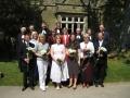 Jaunie draudzes locekļi pēc dievkalpojuma kopā ar garīdzniekiem