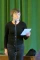 Māc. Elīza Zikmane lasa ziņojumu no Rietumanglijas - Velsas draudzes