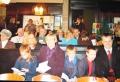 Ziemsvētku dievkalpojums Sv. Annas un Sv. Agneses baznīcā. Priekšplānā Auziņu ģimene. (2005.g.)